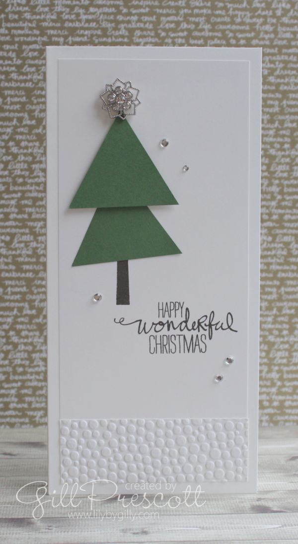 Frosted finishes metal embellishment on a punch art Christmas tree bright